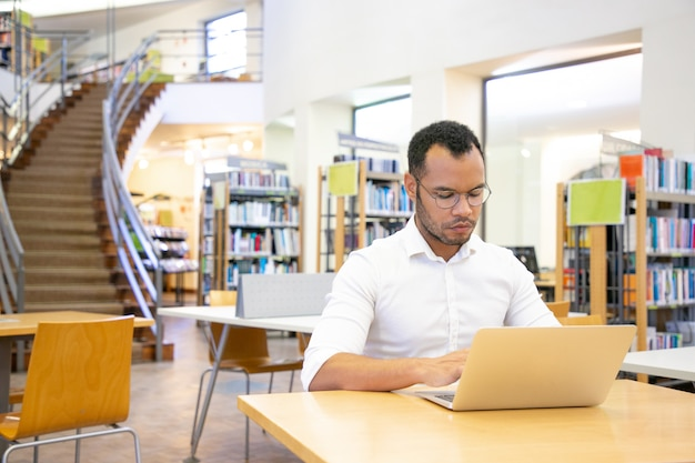Serious adult student doing research in library