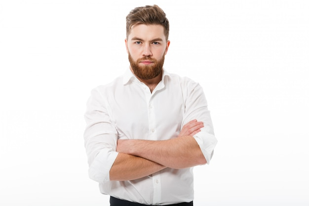 Serious bearded man in business clothes looking
