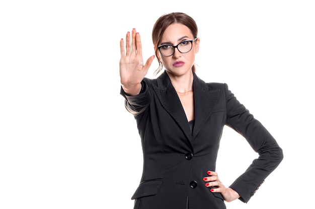 Serious businesswoman showing stop gesture with a palm of hand. isolated on white.