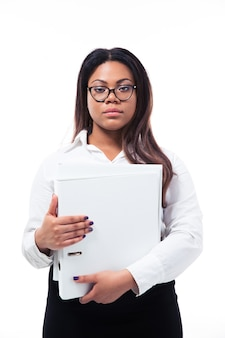 Serious businesswoman standing with folder