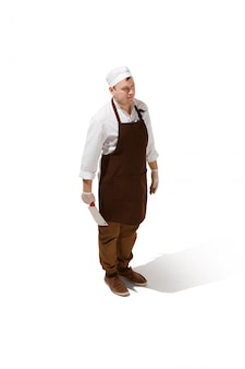 Serious butcher posing with a cleaver isolated
