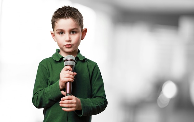 Serious child with a microphone