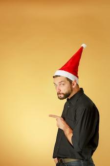 The serious christmas man wearing a santa hat