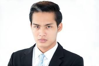 Serious confident Asian man looking at camera