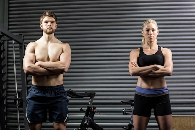 Serious couple posing at gym