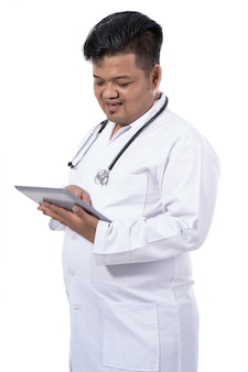 Serious doctor holding tablet digital