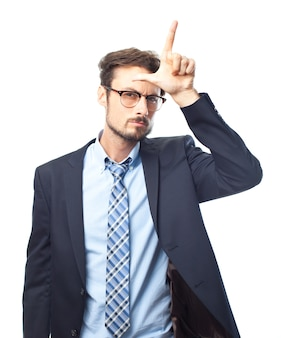 Serious elegant man making the loser gesture with his hand
