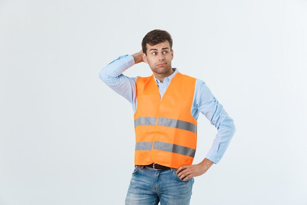 Serious engineer standing with looking away studio shot isolated on white.