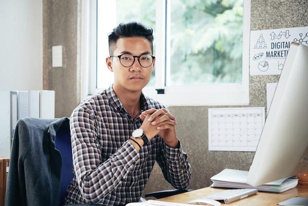 Serious entrepreneur in plaid shirt