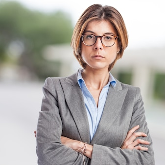 Serious executive with short hair and crossed arms