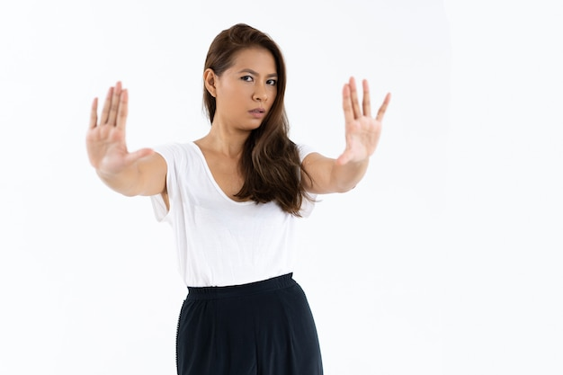 Serious girl gesturing stop