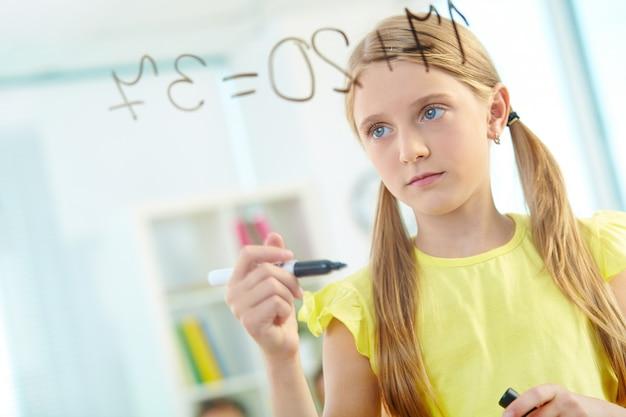 Serious girl solving maths sums