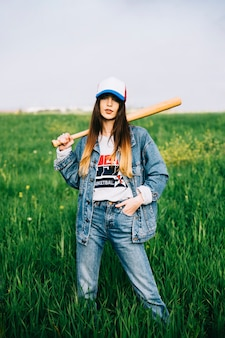 Serious lady in jeans in field