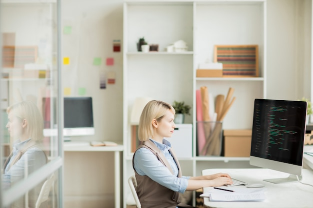 Serious lady working with computer language