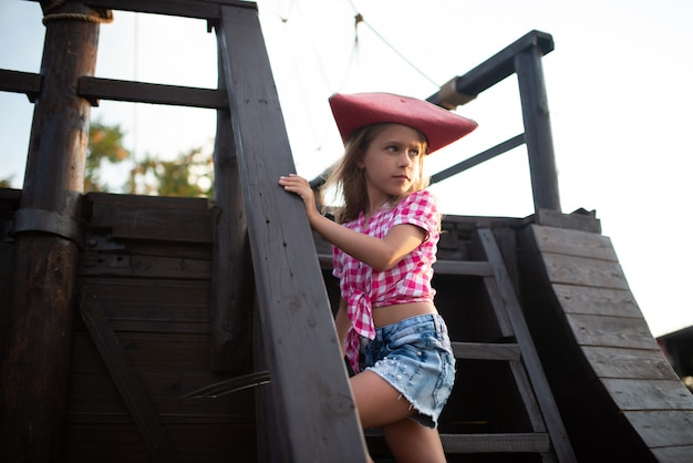 Serious little pirate girl in a plaid shirt