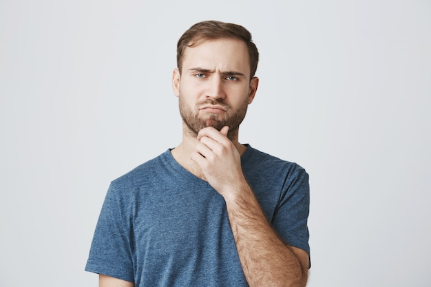 Serious-looking thoughtful man making decision