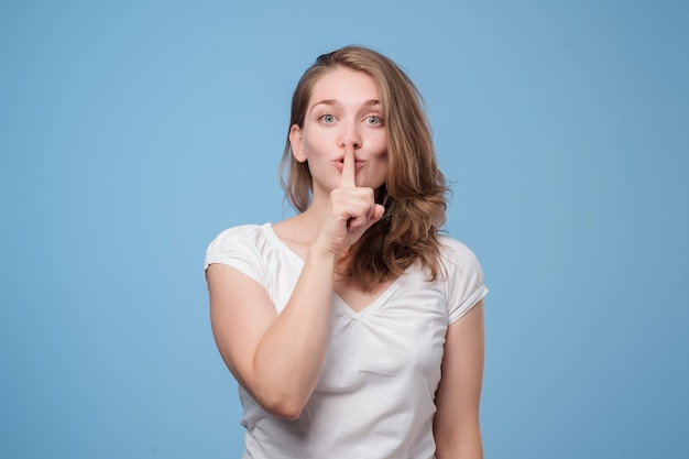Serious lovely woman asks to keep secret information confidential.