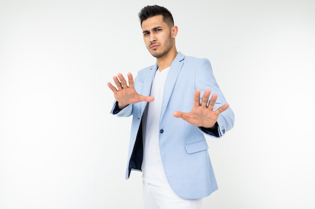 Serious man in a classic image refuses on a white background with copy space