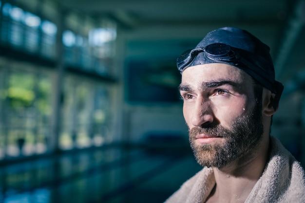 Serious man looking at something at the pool