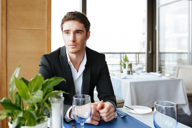 Serious man in restaurant
