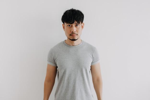 Serious man on white background
