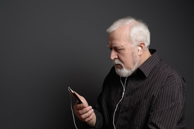 Serious man with headphones and phone