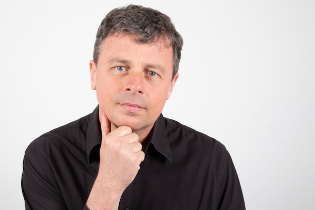 Serious middle-aged man with hand on chin