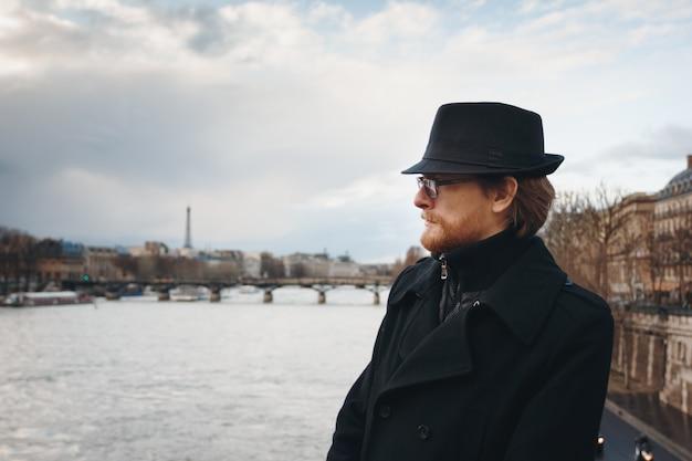 Serious pensive bearded man wearing hat in paris