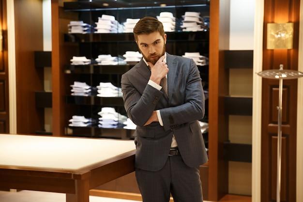 Serious pensive man in shop