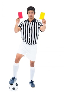 Serious referee showing red and yellow card