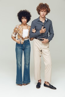 Serious retro loving couple standing and posing