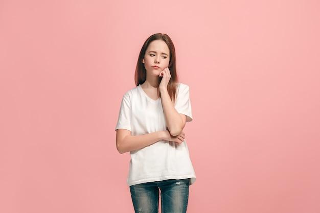 Serious, sad, doubtful, thoughtful teen girl standing at studio