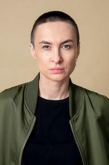 Serious skinhead woman in studio shoot