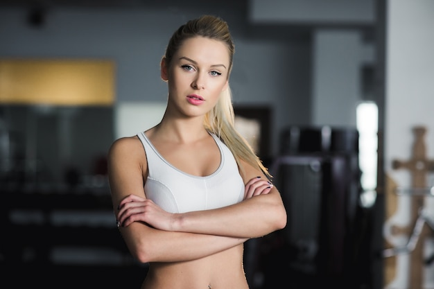Serious sportswoman with crossed arms