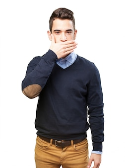 Serious teen covering his mouth
