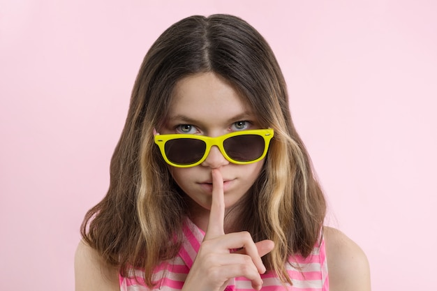 Serious teenage girl show off silence sign
