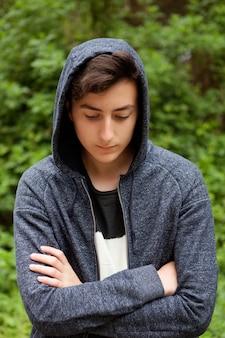 Serious teenager guy