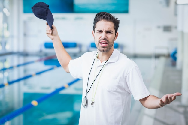 Serious trainer angry at someone at the pool