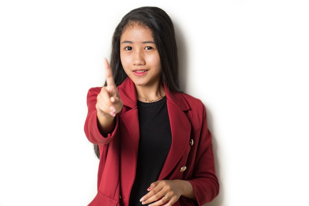 Serious upset asian woman showing stop hand gesture