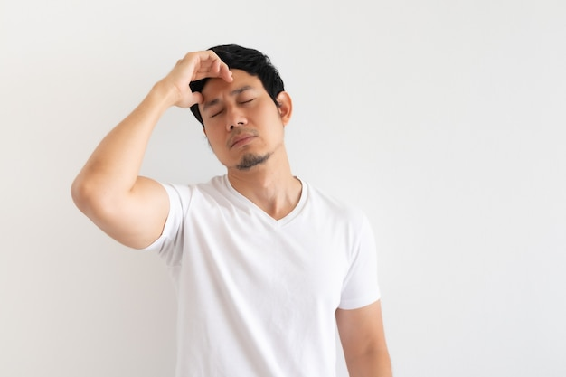 Serious and upset man wears white t-shirt isolated on white background.