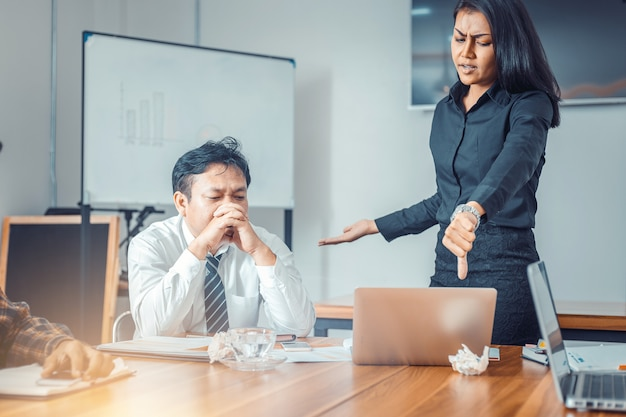 Serious woman boss scolding marketing team employee for bad business result