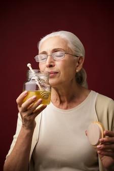 Serious woman holding honey