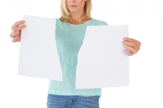 Serious woman holding torn sheet of paper