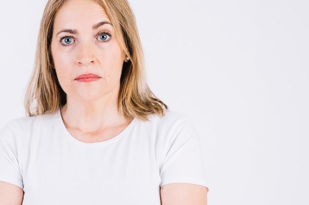Serious woman raising eyebrow