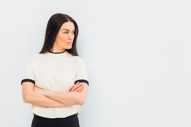 Serious woman standing with crossed arms