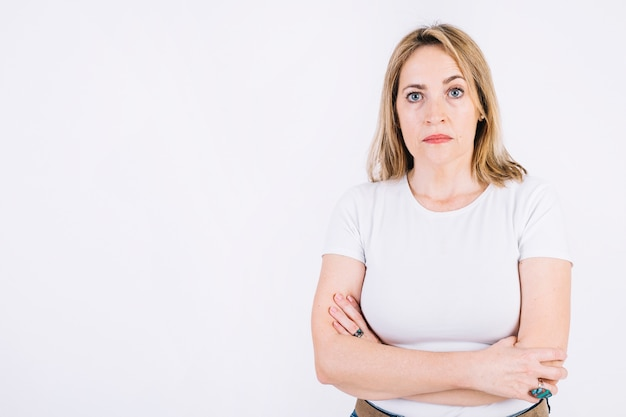 Serious woman with crossed arms