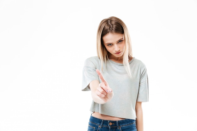 Serious young lady showing stop gesture.