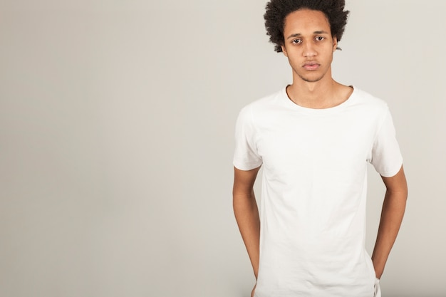 Serious young man in t-shirt