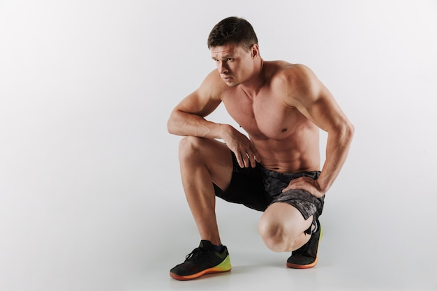 Serious young sportsman make sport exercises