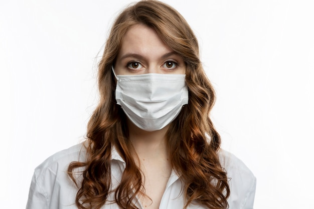 Serious young woman in a medical mask. quarantine during the coronavirus pandemic.
